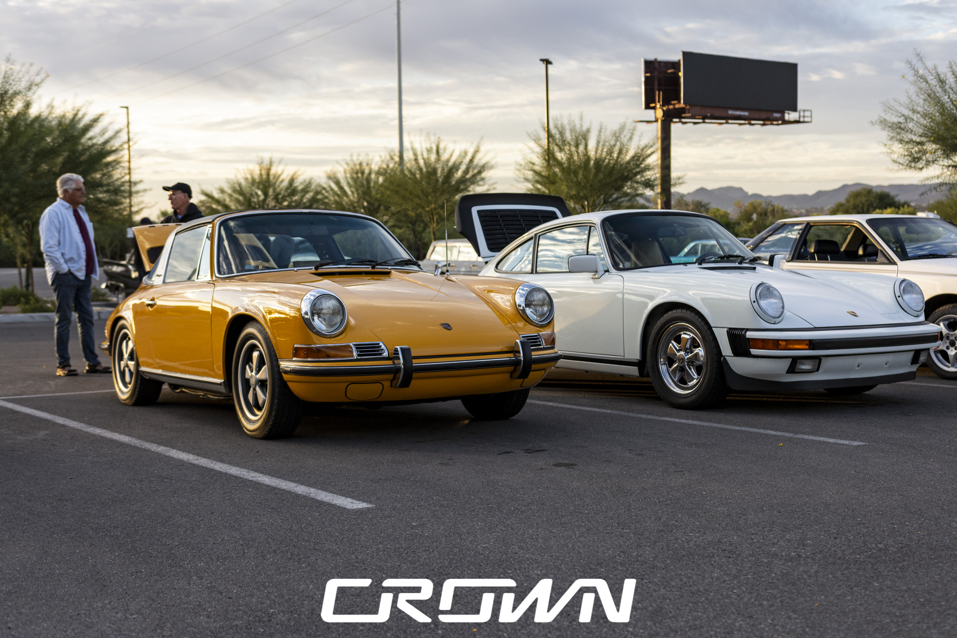 Two classic Porsche 911 parked at car show
